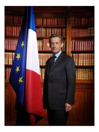French President Nicolas Sarkozy poses for an official portrait next to the French and European Community flags, in the Elysee Palace library, in Paris, Monday, May 21, 2007. This photo will be displayed in French city halls and schools and in French embassies. (AP Photo/Philippe Warrin)